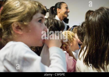 Speaker of the Knesset Reuven Rubi Rivlin and Minister of Education Gideon Saar interact with kindergarten children - Stock Photo