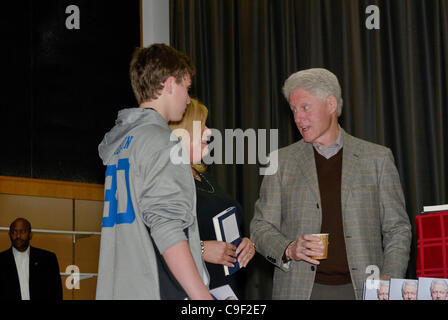 President Bill Clinton signs copies of his new book Back to Work at his hometown library  in Chappaqua, New York. - Stock Photo