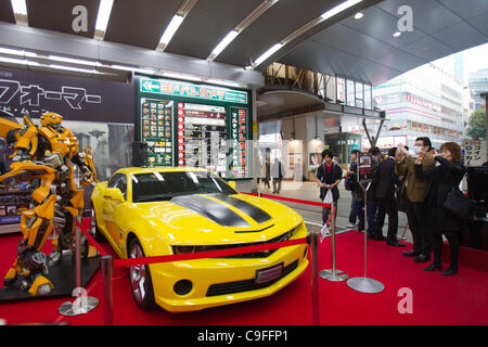 Dec 15, 2011, Tokyo, Japan - People take photos of the large scale figure of Bumblebee from the movie, 'Transformers - Stock Photo