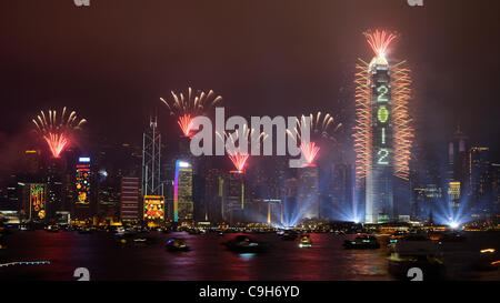 01 January 2012, Hong Kong --- Fireworks explode over Victoria harbour and the city skyline to celebrate New Year's - Stock Photo