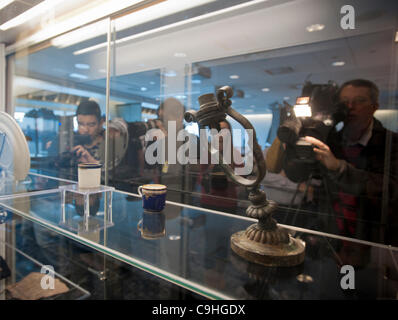 Salvaged artifacts are on display at a media preview for the auction of the salvaged material recovered from the - Stock Photo