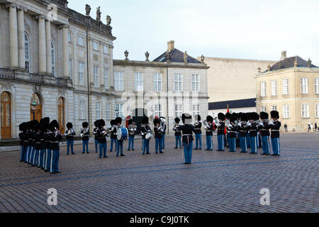 Jan.Tuesday 10, 2012 - Amalienborg Palace, Copenhagen, Denmark - The Royal Life Guards with an extended musical - Stock Photo
