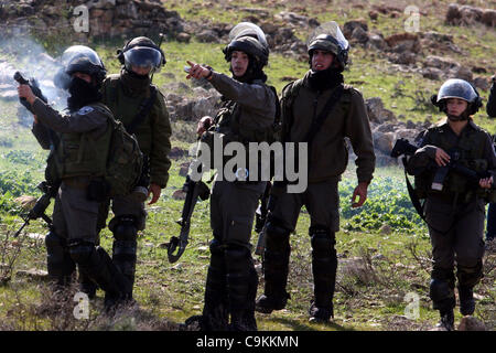 Jan. 21, 2012 - Ramallah, West Bank, Palestinian Territory - An Israeli border police officer fires a tear gas canister - Stock Photo