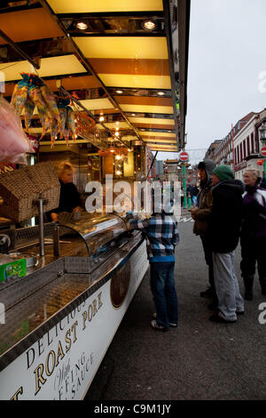 Caterers, Roast pork, takeout, takeaway at the Chinese Year of the Dragon Liverpool City centre Parade and Festival - Stock Photo