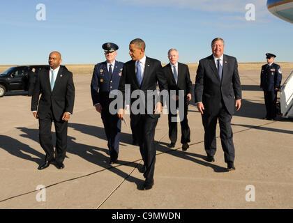President Barack Obama with Denver Mayor Michael Hancock (L), Col. Daniel A. Dant, the 460th Space Wing commander, - Stock Photo