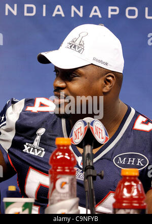 New England's Brian Waters (54) answers questions during the Super Bowl XLVI media day in Lucas Oil Stadium.  Spectators - Stock Photo