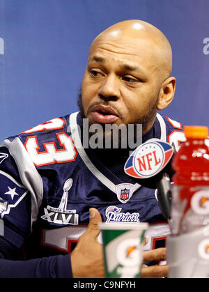 New England's Kevin Faulk (33) answers questions during the Super Bowl XLVI media day in Lucas Oil Stadium.  Spectators - Stock Photo