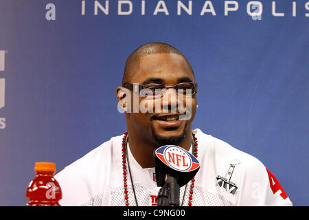 New York's Amad Bradshaw (44) answers questions during the Super Bowl XLVI media day in Lucas Oil Stadium.  Spectators - Stock Photo