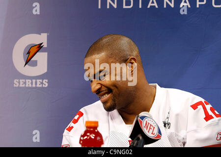 New York's Osi Umenyiora (72) answers questions during the Super Bowl XLVI media day in Lucas Oil Stadium.  Spectators - Stock Photo