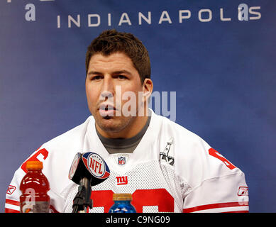 New York's David Diehl (66) answers questions during the Super Bowl XLVI media day in Lucas Oil Stadium.  Spectators - Stock Photo