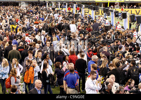 Members of the media fill part of Lucas Oil Stadium during media day for Super Bowl XLVI.  Spectators were allowed - Stock Photo