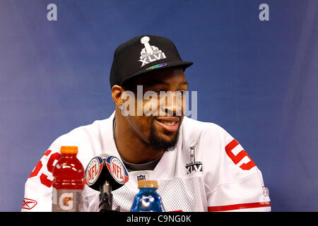 New York's Michael Boley (59) answers questions during the Super Bowl XLVI media day in Lucas Oil Stadium.  Spectators - Stock Photo