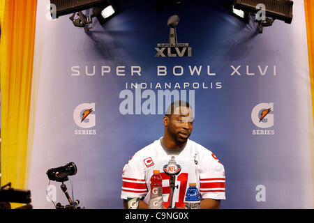 New York's Justin Tuck (91) answers questions during the Super Bowl XLVI media day in Lucas Oil Stadium.  Spectators - Stock Photo