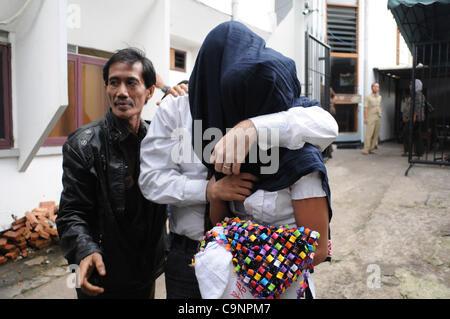 Feb. 2, 2012 - Jakarta, Indonesia - A Swedish citizen,ORJAN ROBERT ELEVSSON (38 years)  with his Girlfriend NARAWADEE - Stock Photo