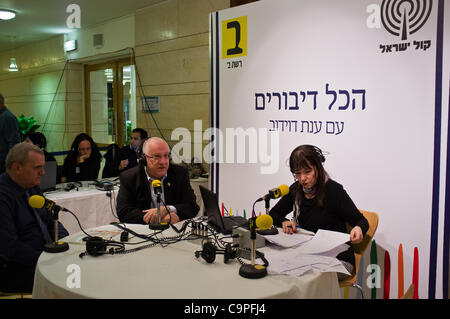"""Speaker of the Knesset, Reuven """"Rubi"""" Rivlin (center), does an interview for Channel B Radio from an improvised - Stock Photo"""