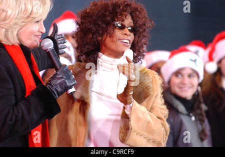 Dec. 8, 2002 - New York, New York, U.S. - DIANE SAWYER introduces singer WHITNEY HOUSTON before she performs songs - Stock Photo