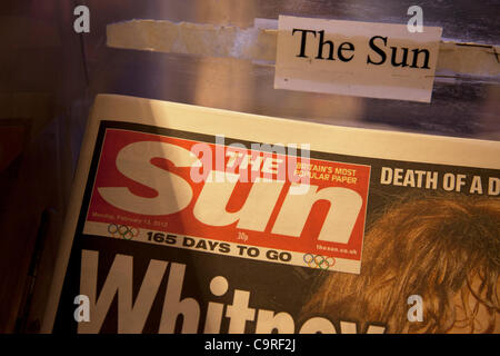 The Sun newspaper for sale at a newsstand in London, England, UK. British police arrested five senior members of - Stock Photo