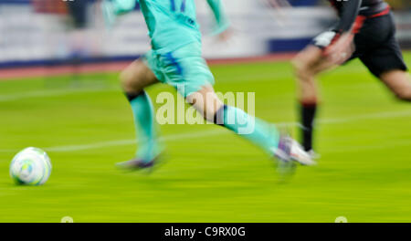 Soccer, UEFA Champions League, Leverkusen vs. FC Barcelona 1:3 --- blurred legs and ball - Stock Photo