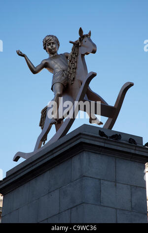 Bronze sculpture of a boy on a rocking horse on the Fourth Plinth in Trafalgar Square, London. Artists Michael Elmgreen - Stock Photo