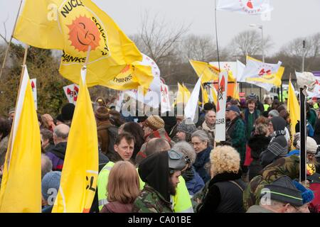 ' Police engagement officers '  try to talk to Protesters at a march against the building of  Hinkley C power station, - Stock Photo