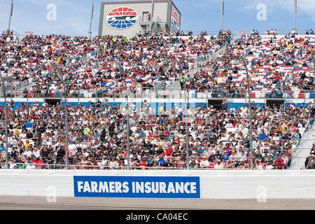 March 11, 2012 - Las Vegas, Nevada, U.S - The crowd enjoying the exciting racing action at the NASCAR Sprint Cup - Stock Photo