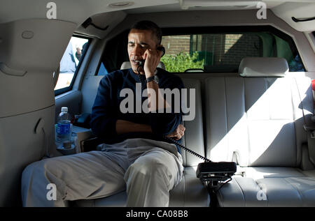 President Barack Obama talks on the phone with Afghanistan President Hamid Karzai from the presidential limousine - Stock Photo