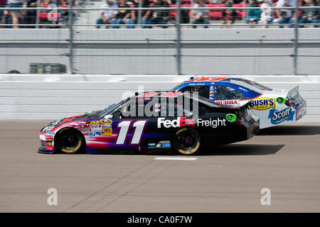 March 11, 2012 - Las Vegas, Nevada, U.S - Denny Hamlin, driver of the #11 FedEx Freight Toyota Camry, battles to - Stock Photo