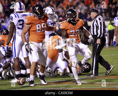 Nov. 12, 2011 - Charlottesville, Virginia, United States - Running back Perry Jones (33) and tight end Colter Phillips - Stock Photo