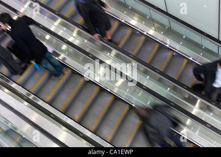 Escalators provide access to the mezzanine level and make the London's Kings Cross Station feel more like an airport - Stock Photo