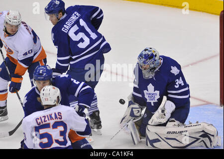 March 20, 2012 - Toronto, Ontario, Canada - Toronto Maple Leafs goalie James Reimer (34) makes a stop with New York - Stock Photo