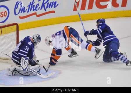 March 20, 2012 - Toronto, Ontario, Canada - Toronto Maple Leafs goalie James Reimer (34) makes the save as Toronto - Stock Photo