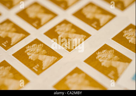 A sheet of first-class postage stamps. They will rise 30%  in price from 46p to 60p from 30 April 2012 after the - Stock Photo