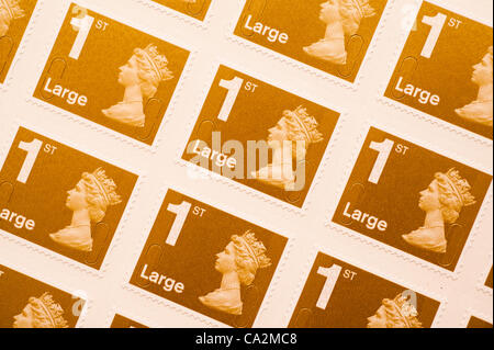 A sheet of large first-class postage stamp.They will rise 30%  in price from 46p to 60p from 30 April 2012 after - Stock Photo