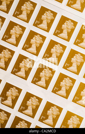 A sheet of first-class postage stamp.They will rise 30%  in price from 46p to 60p from 30 April 2012 after the UK - Stock Photo