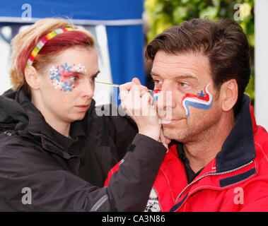 2nd June 2012: TV presenter Nick Knowles, having his face painted, at the Diamond Jubilee street party held in Hawes - Stock Photo