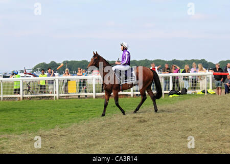 02/06/12. Epsom Downs, Surrey, UK. Astrology ridden by jockey Ryan Moore make their way to the start of The Derby - Stock Photo