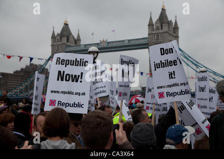 London, UK. 3rd June 2012  Around 100 protestors from the Group Republic with Tower Bridge in the background. They - Stock Photo