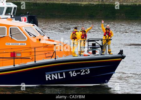 LONDON, UK, 3rd June 2012. The RNLI wave to spectators. - Stock Photo