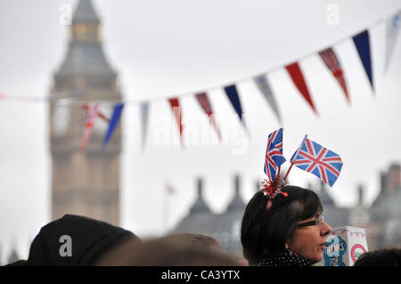 3rd June 2012. Southbank, London, UK. A woman wearing Union Jack flags, with Big Ben in the background as the crowd - Stock Photo