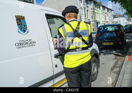 Ceredigion County Council 'Parking Enforcement Officers' on the streets of Aberystwyth on the first day of their - Stock Photo