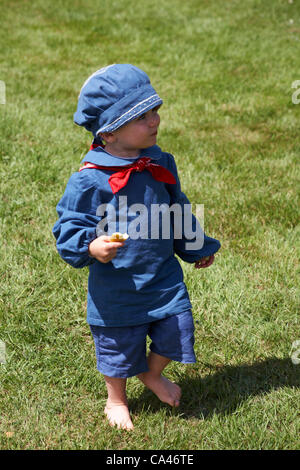 Isle of Wight, UK Sunday 3 June 2012. Jubilee celebrations at Osborne House. Toddler dressed in Victorian period - Stock Photo