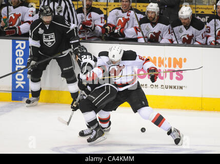 06 June 2012: Devils (8) Dainius Zubrus shoves Kings (26) Slava Voynov as they fight for the puck during game 4 - Stock Photo