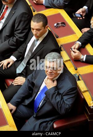 May 17 2012, Athens, Greece. Ilias Kasidiaris(top left), Golden Dawn and leader Michaloliakos in parliament. June - Stock Photo