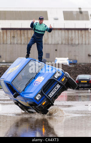 Northern Ireland, Belfast 08/06/2012 - Steven Flaherty drives a Diahatsu on two wheels while Mark Glover stands - Stock Photo