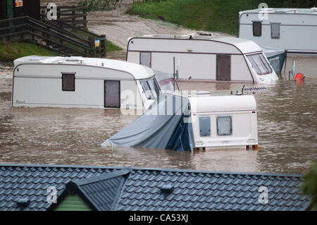 Ceredigion, Wales, UK. Saturday June 9 2012. Caravans and cars submerged by the waters of the River Leri at the - Stock Photo