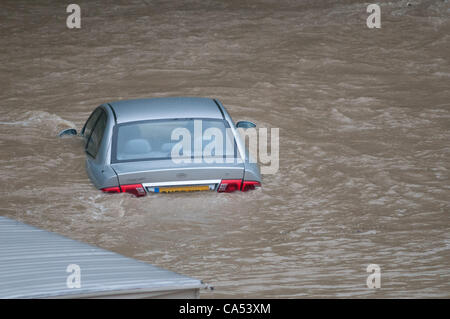 Ceredigion, Wales, UK. Saturday June 9 2012. A car is submerged by the waters of the River Leri at the Riverside - Stock Photo
