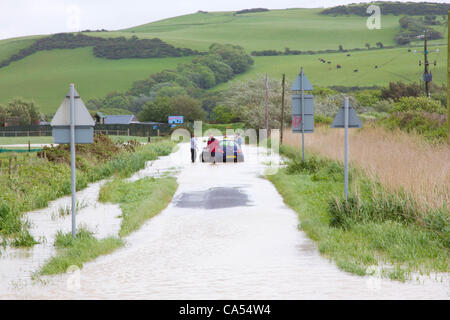 Saturday 9th June 2012. A car stranded in flood water near the Animalarium in Borth, North Ceredigion, Wales, UK. - Stock Photo