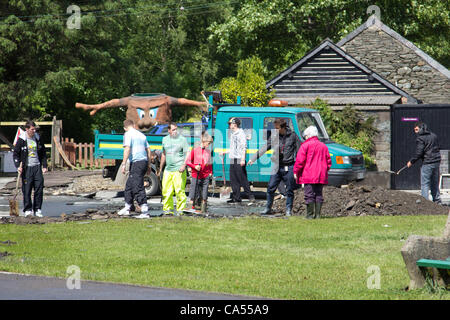 Saturday 9th June 2012, Talybont, mid Wales, UK. Villagers pull together to clean-up following the flash floods - Stock Photo