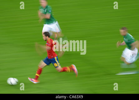 14.06.2012, GDANSK, Poland. Spain's Jordi Alba (L)escapes from two Irish players during UEFA EURO 2012 group C soccer - Stock Photo