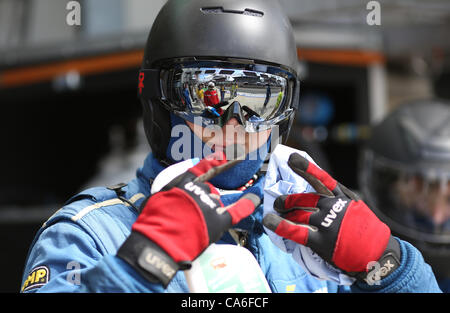 16.06.2012. Le Mans, France, Circuit de la Sarthe. A mechanic of Team Felbermayr-Proton poses for a photo during - Stock Photo